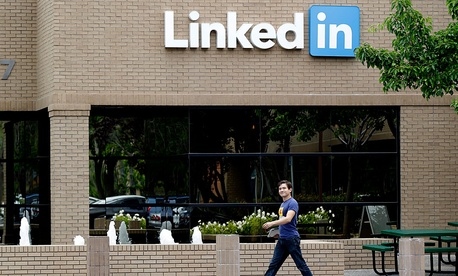 A man walks past the LinkedIn headquarters in Mountain View , Calif.