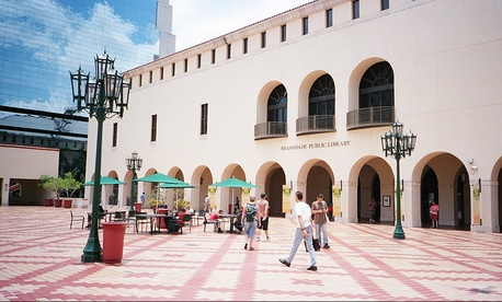 Miami-Dade Mayor Carlos Gimenez has proposed slashing nearly 100 full-time public library positions.