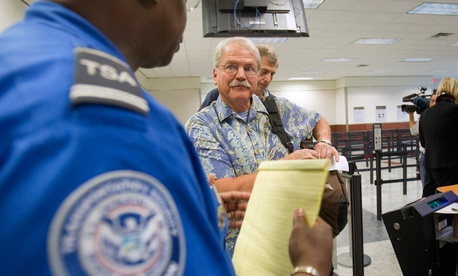 A TSA officer briefs a passenger in Atlanta in 2011.