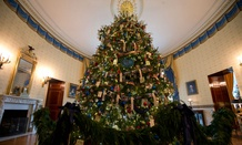 The ornament laden White House Christmas tree is seen in the Blue Room of the White House in Washington, Wednesday, Dec. 4, 2013.