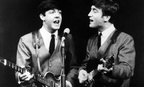 Paul McCartney, left, and John Lennon perform in London, on Nov. 11, 1963.