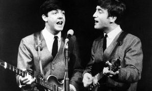 aul McCartney, left, and John Lennon perform in London, on Nov. 11, 1963.