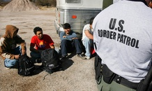 Immigrants are detained by the Arizona border in 2007.