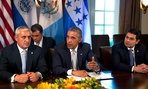 Guatemala's President Otto Perez Molina, left, listens as U.S. President Barack Obama speaks to the media next to Honduran President Juan Hernandez after they met to discuss Central American immigration and the border crisis.