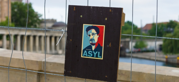 A poster of Edward Snowden's face hangs in Berlin in June after a rally.