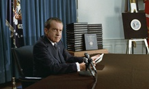 President Nixon, with edited transcripts of Nixon White House Tape conversations during broadcast of his address to the Nation in 1974.