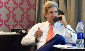 U.S. Secretary of State John Kerry works the phones on July 25 in Cairo to negotiate a ceasefire in Gaza.