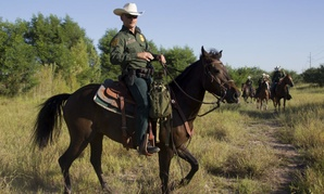Border Patrol agents from the McAllen station horse patrol unit on patrol in South Texas.