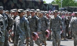 Soldiers from the Army's 3rd Infantry Regiment place flags at Arlington National Cemetary prior to Memorial Day weekend.