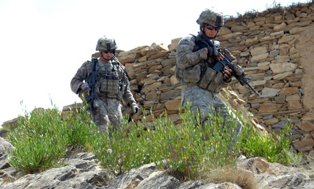 U.S. Army troops patrol for possible improvised explosive devices after clearing a building Kandarou, Afghanistan, in 2009.