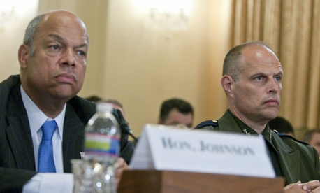 DHS Secretary Jeh Johnson (left) testifies in June with Border Patrol Deputy Chief Ronald Vitiello on the problem of unaccompanied minors crossing the border.
