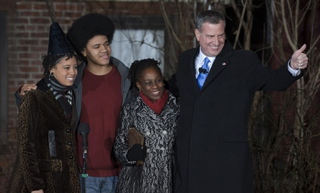 Bill de Blasio, at right, stands with his family outside their Brooklyn home shortly after being sworn in as New York City mayor on Jan. 1, 2014.