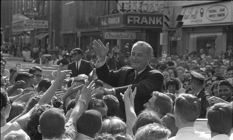 President Lyndon B. Johnson shakes hands with crowd members in June 1966.