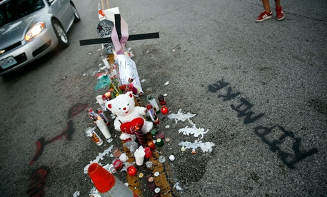 A memorial sits where Michael Brown died over the weekend.