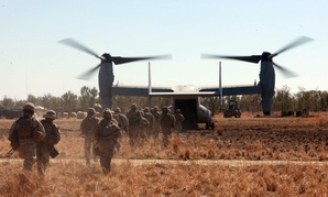 Marines with the Marine Rotational Force-Darwin load into an MV-22B Osprey during Exercise Koolendong at Bradshaw Training Field Area, Northern Territories, Australia.