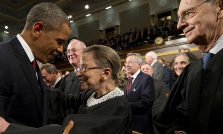 President Barack Obama greets Supreme Court Justice Ruth Bader Ginsburg prior to his State of the Union address in front of a joint session of Congress on Tuesday, Jan. 24, 2012.