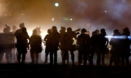 Police confront protestors Wednesday night.