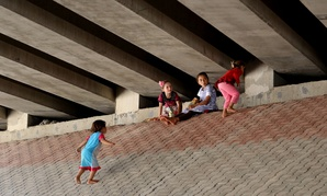 Displaced Iraqi Yazidi children play under a bridge in central Dahuk Thursday.