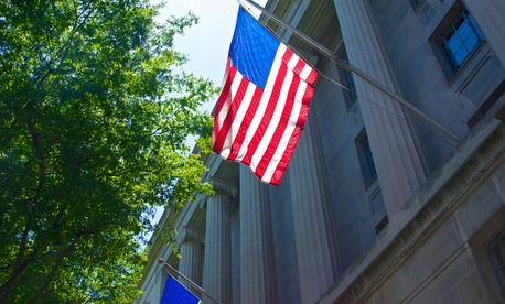 A flag hands on the Department of Justice headquarters in Washington.