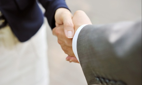 As far as touching, stick with the handshake in the office.