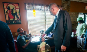Attorney General Eric Holder visits Drake's Place restaurant for a meeting with community leaders on Aug. 20 in Ferguson.