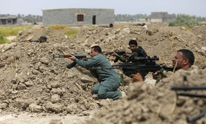 Iraqi Shiite fighters prepare to fight ISIL militants in Jurf al-Sakhar, on Monday.