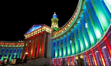The Denver City-County Building all lit up in a holiday display.