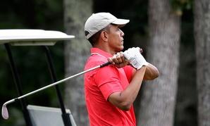 Obama follows through during a round Saturday.