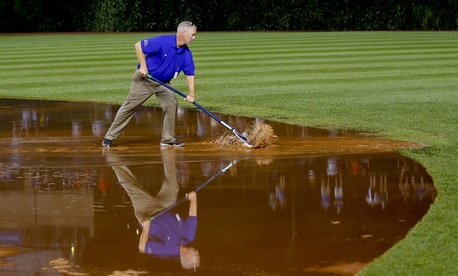 A member of the grounds crew works on the infield at Chicago's Wrigley Field on August 21