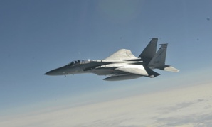 An F-15C fighter jet similar to the one that crashed awaits midair refueling.
