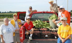 Bread of Life Food Pantry volunteers stand beside a truckload of the fruits and vegetables collected in support of the Agriculture Department's Feds Feed Families campaign in Tipton, Iowa, in July 2012.