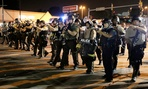 Police advance during a protest in Ferguson on Aug. 18.
