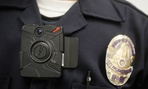 A Los Angeles Police officer wears an on-body camera, similar to the ones implemented in Ferguson, Mo., during a demonstration for media in Los Angeles.