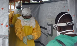 Dr. Tom Frieden, Director of the U.S. Centers for Disease Control and Prevention, is decontaminated last week after visiting aid workers in Africa.
