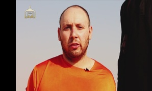 A screenshot from the video released by SITE Intelligence Group shows American journalist Steven Sotloff prior to his purported beheading.