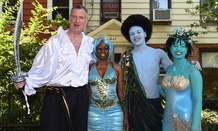 New York City Mayor Bill de Blasio and his family dressed up for the Mermaid Parade in June.
