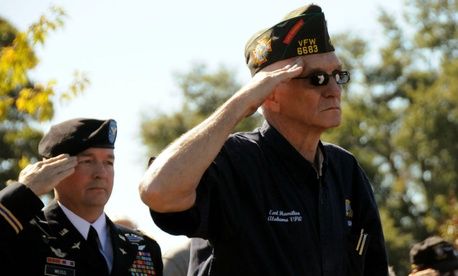 Veterans salute the colors during a Veterans Day ceremony.