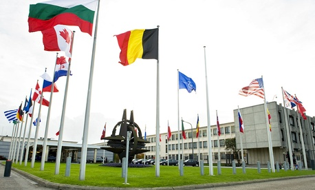 Member flags fly outside NATO's Brussels headquarters.