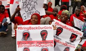 Demonstrators rally in support of girls kidnapped by Boko Haram in May in  Abuja, Nigeria.