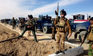 Iraqi Security Forces, on February 2, 2014, prepare to attack Islamic State militants in the western city of Ramadi.