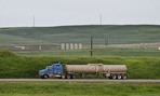 An oil truck drives through McKenzie County, North Dakota, near Watford City.