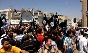 Supporters of the Islamic State rally in Mosul in June.