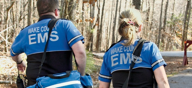 Emergency responders prepare to treat an injured visitor  at Umstead State Park in North Carolina, where EMS research has improved patient survival rates.
