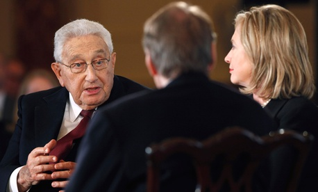 Henry Kissinger and Hillary Clinton speak during an interview with Charlie Rose in 2011.