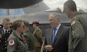 Undersecretary of Defense Frank Kendall speaks with service members at the 2014 Farnborough International Airshow