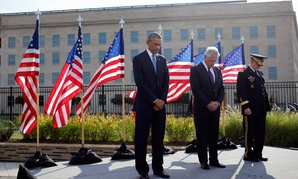 Barack Obama, Chuck Hagel and Martin Dempsey observe a moment of silence at the Pentagon Thursday.