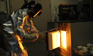 A Naval Surface Warfare Center scientist tests materials at the Carderock Ceramics Lab in Maryland.