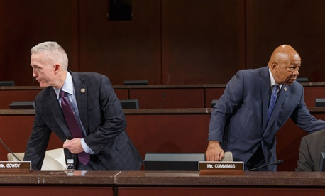 Rep. Trey Gowdy, R-S.C., chairman of the House Select Committee on Benghazi, and Rep. Elijah Cummings, D-Md., right, the ranking member, arrive as the panel holds its first public hearing Wednesday.