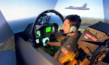 A Navy F/A-18 pilot at Naval Air Station LeMoore, California, trains in 2005 in a simulator built and maintained by industry.