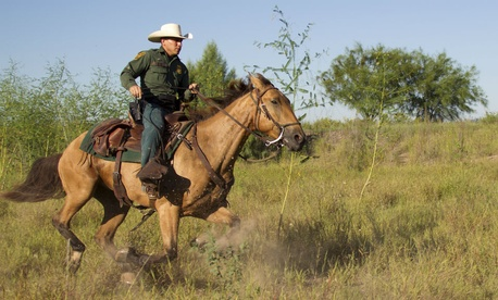 An agent patrols on horseback in South Texas.